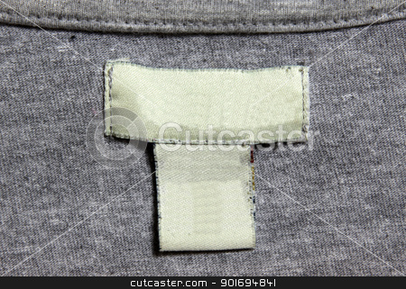 Grey Shirt, White Label stock photo, A grey shirt and a white label.  by Chris Hill