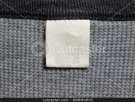 Grey Shirt and Label stock photo, A grey shirt and a white label.  by Chris Hill