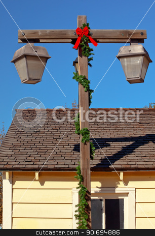 Christmas Lamp Post Old San Diego Town Roofs California  stock photo, Christmas Lamp Post Old San Diego Town Roofs California by William Perry