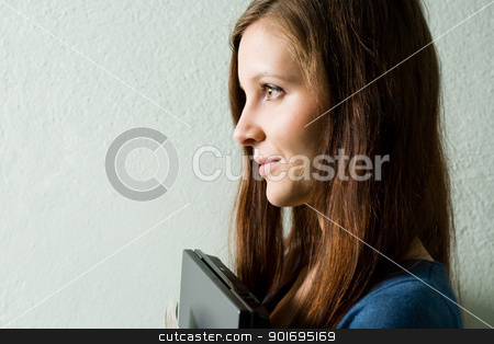 Looking forward. stock photo, Looking forward, closeup profile portrait of a brunette student girl holding laptop. by exvivo