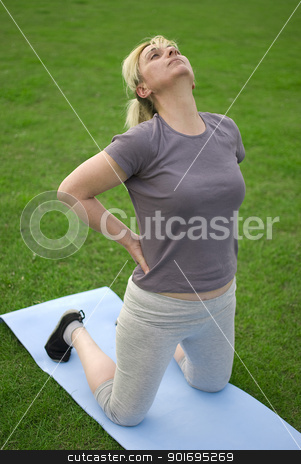 middle aged woman exercising stock photo, middle aged woman keeping fit with exercises in a park by Desislava Dimitrova
