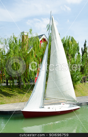 Sailboat docking. stock photo, Sailboats in a quiet harbor on ocean by chatchai