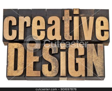 creative design in wood type stock photo, creative design - creativity concept - isolated text in vintagw letterpress wood type by Marek Uliasz