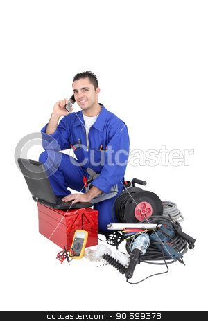Electrician surrounded by equipment stock photo, Electrician surrounded by equipment by photography33
