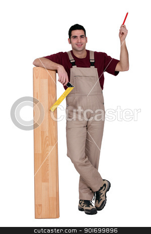 Worker with wooden flooring stock photo, Worker with wooden flooring by photography33