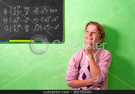 Boy in classroom with wondering expression stock photo, Young attractive boy standing in front of blackboard with wondering face expression. by karel noppe