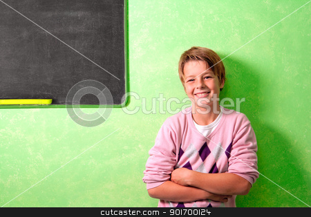 Young student in classroom in front of blackboard stock photo, Young handsome student in colorful classroom in front of blackboard by karel noppe