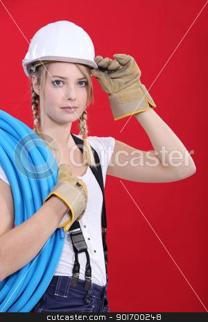 Young tradeswoman giving a salute stock photo, Young tradeswoman giving a salute by photography33