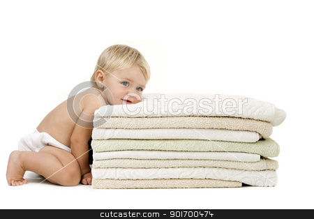 Baby girl resting head on towels stock photo, Blue eyed baby girl with relaxed expression resting her head on a pile of towels. Isolated on white background. by karel noppe