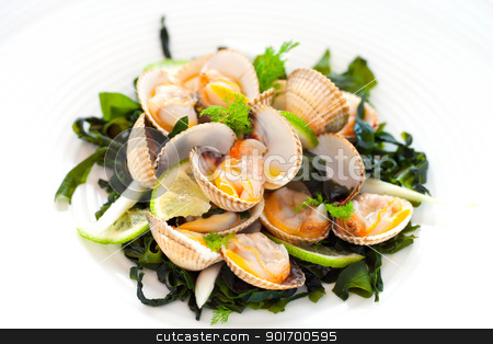 Shellfish Clam appetizer. stock photo, Macro close up of clam starter with lemon and greens.. by karel noppe