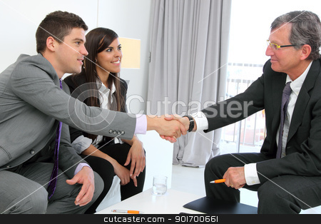 Business couple shaking hands with partner. stock photo, Business couple shaking hands with financial planner. by karel noppe