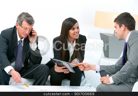 Business people at meeting. stock photo, Business people at financial meeting with architectural plans on table. by karel noppe