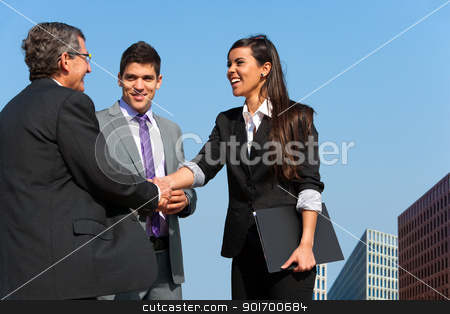 Business team shaking hands over deal outdoors. stock photo, Young business couple shaking hands with partner outdoors. by karel noppe