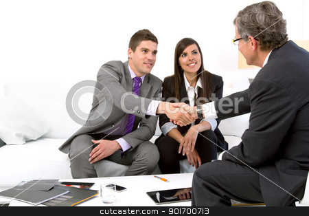 Young couple at meeting with financial planner. stock photo, Young attractive couple meeting with financial planner.  by karel noppe