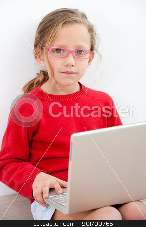 Portrait of young girl with laptop. stock photo, Portrait of cute blond girl doing homework with laptop.  by karel noppe