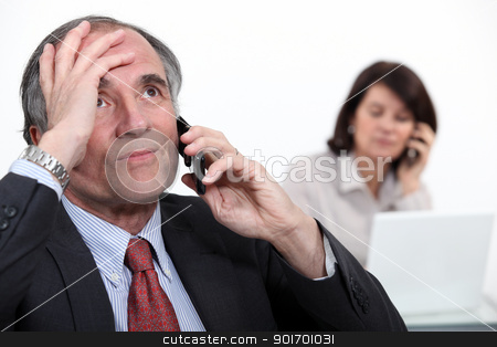 Stressful telephone call stock photo, Stressful telephone call by photography33
