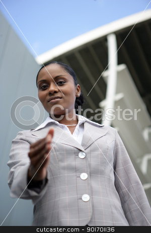 Businesswoman offering you her hand stock photo, Businesswoman offering you her hand by photography33