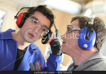Men wearing ear defenders stock photo, Men wearing ear defenders by photography33