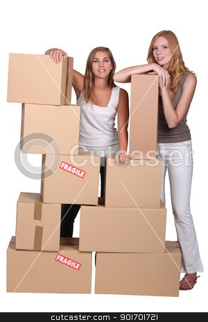 Girls surrounded by boxes stock photo, Girls surrounded by boxes by photography33