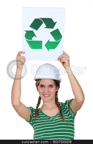 A female construction worker holding a recycling sign. stock photo, A female construction worker holding a recycling sign. by photography33