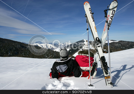 Two skiers sat in the snow with their back to the camera stock photo, Two skiers sat in the snow with their back to the camera by photography33
