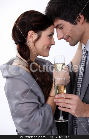 Elegant young couple drinking champagne stock photo, Elegant young couple drinking champagne by photography33