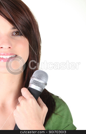 Young brunette holding micro[hone stock photo, Young brunette holding micro[hone by photography33