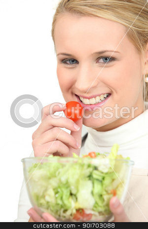 Blond girl eating salad stock photo, Blond girl eating salad by photography33