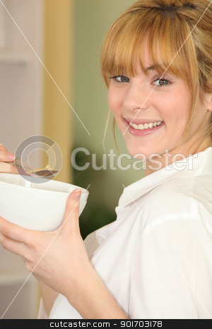 Woman with bowl of cereal stock photo, Woman with bowl of cereal by photography33