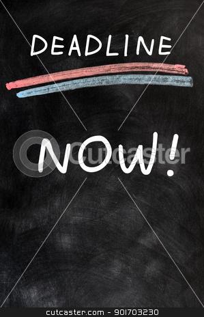 Deadline Now written on a blackboard  stock photo, Deadline Now written with chalk on a blackboard  by John Young