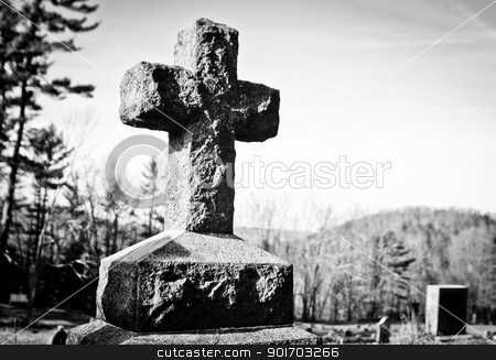 Black and white cross stock photo, Black and white cross in a graveyard by Angela Schmidt
