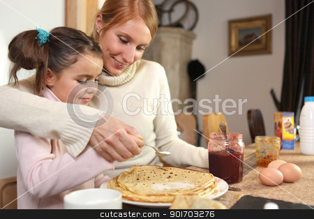 loving mother making crepes with little girl stock photo, loving mother making crepes with little girl by photography33