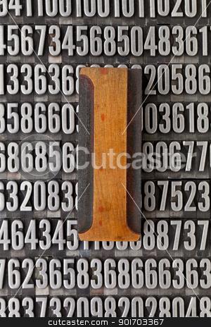 number one - numerical abstract stock photo, number one in vintage letterpress wood type against background of random metal numbers by Marek Uliasz
