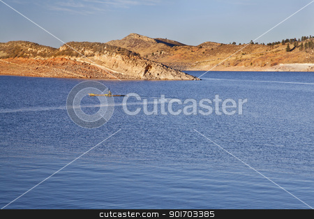 sea kayak on a Colorado mountain lake stock photo, sea kayak on Horsetooth Reservoir near Fort Collins, Colorado, late summer or fall scenery in sunset light by Marek Uliasz