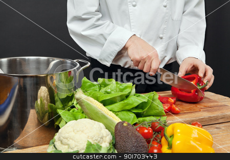 Chopping vegetables stock photo, Photo of a chef chopping vegetables on a wooden cutting board. by © Ron Sumners
