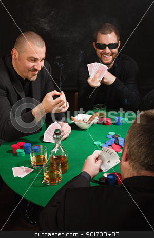 Fun card game stock photo, Photo of three men playing poker, smoking cigars, drinking whiskey and one flipping the bird at the player with the good poker hand. by © Ron Sumners