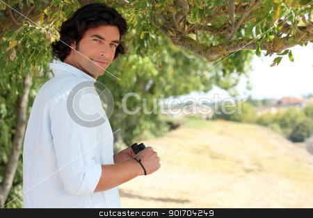 Man with binoculars in the countryside stock photo, Man with binoculars in the countryside by photography33