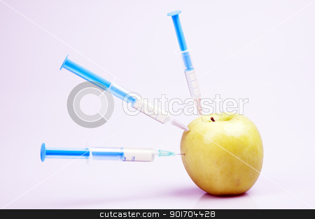Genetically modified fruits and vegetables by injection of chemistry substance stock photo, Genetically modified fruits and vegetables by injection of chemistry substance by fikmik