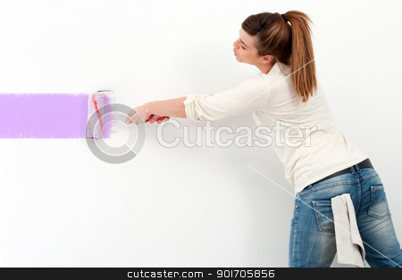 Cute girl painting the wall. stock photo, Portrait of cute female painter painting the wall with color paint. by karel noppe