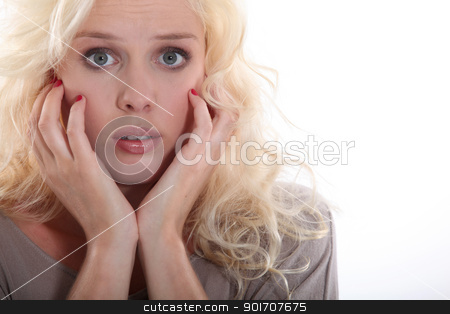 portrait of young blonde looking scared stock photo, portrait of young blonde looking scared by photography33