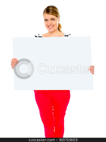 Pretty lady displaying blank placard stock photo, Pretty lady displaying blank placard against white background by Ishay Botbol