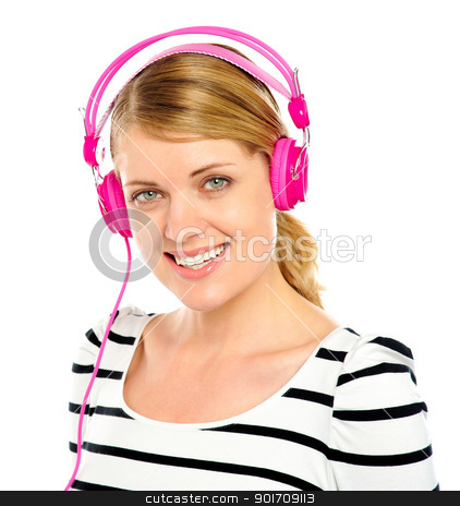 Attractive cheerful woman enjoying music stock photo, Attractive cheerful caucasian woman listening and enjoying music in headphones by Ishay Botbol