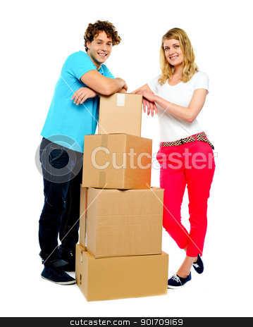 Teenager couple posing beside cardboard boxes stock photo, Teenager couple posing beside cardboard boxes. Full-length shot by Ishay Botbol