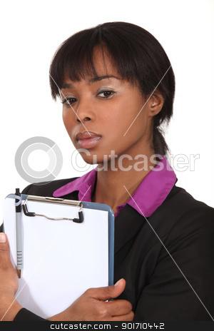 A black businesswoman clipboard. stock photo, A black businesswoman clipboard. by photography33