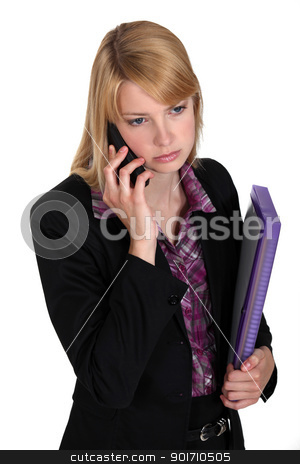 Serious businesswoman with files and a phone stock photo, Serious businesswoman with files and a phone by photography33