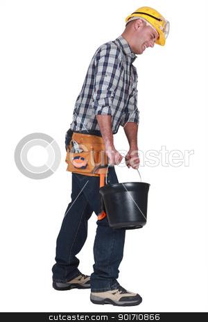 A mason carrying a bucket. stock photo, A mason carrying a bucket. by photography33