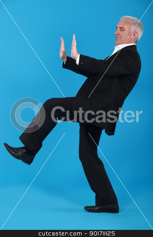 Elderly man pushing object stock photo, Elderly man pushing object by photography33