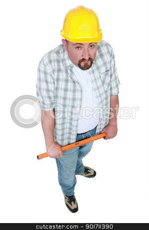 Tradesman holding a tool stock photo, Tradesman holding a tool by photography33