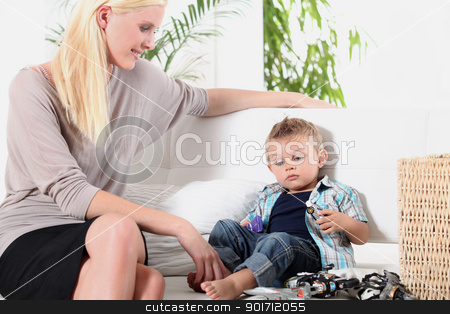 Woman sitting with a little boy stock photo, Woman sitting with a little boy by photography33