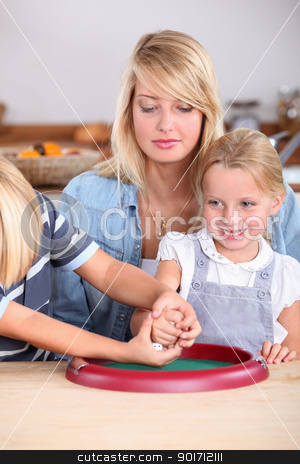 Family playing game with dice stock photo, Family playing game with dice by photography33